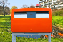 Dutch public orange mailbox on a city street. Royalty Free Stock Photography