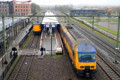 Dutch Railway double deck train entering Steenwijk railway station Royalty Free Stock Photography