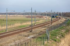 Dutch railway through National Park Oostvaardersplassen near Almere and Lelystad stock image