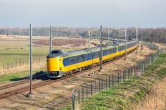 Dutch railway through National Park Oostvaardersplassen near Almere and Lelystad. Dutch railway with express train through National Park Oostvaardersplassen royalty free stock photography