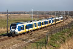 Dutch railway through National Park Oostvaardersplassen near Almere and Lelystad. Dutch railway with local train through National Park Oostvaardersplassen stock photos