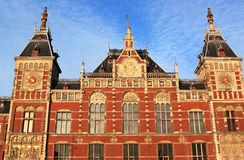 Dutch railway station in evening light, Amsterdam Royalty Free Stock Image