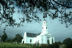 The Dutch Reformed Church. The Dutch Reformed Church in George, Western Cape, South Africa, on a cloudy day, with tree brunches in the top part of the picture Royalty Free Stock Photos