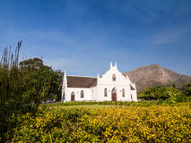 Dutch Reformed Church in Franschhoek. South Africa, on a summer day. Horizontal orientation, wide angle, blue sky in the background Stock Image