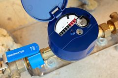 Dutch residential water meter. With the text `drinking water` on the tap royalty free stock photo