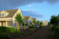 Dutch resort holiday homes by sunrise. Dutch holiday homes with porches. Morning idyll in Zuytland-Buiten, a resort complex at summer by sunrise stock images