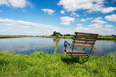 Dutch river the Eem. Landscape with chair near Dutch river the Eem Royalty Free Stock Image