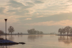 The Dutch river IJssel during sunset in winter Royalty Free Stock Photo