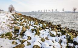 Dutch river in the winter season stock photography