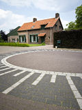 Dutch roundabout. A neat Dutch house with a typical for the Netherlands roundabout made of cobblestone and characteristically painted Stock Photo