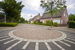 Dutch roundabout. A neat Dutch house with a typical for the Netherlands roundabout made of cobblestone and characteristically painted Royalty Free Stock Photography