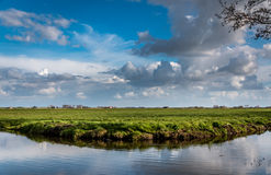 Dutch rual landscape. Canals flow through farmland in rural Holland Stock Photo