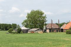 Dutch rural landscape with old farmhouse Royalty Free Stock Images