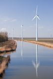 Dutch rural landscape with windturbines Stock Photos