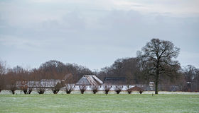 Dutch rural winter landscape with farm house. Stock Image