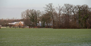 Dutch rural winter landscape with old house. Stock Photo