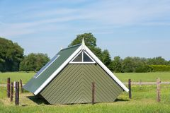 Dutch salt house for salt extraction. Dutch wooden salt house for salt extraction in landscape Stock Images