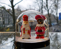 Dutch Santa Claus figures in Amsterdam shop window royalty free stock photography