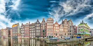Dutch scenery with its canal side houses. Amsterdam panoramic sk Stock Images