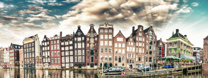 Dutch scenery with its canal side houses. Amsterdam panoramic sk Royalty Free Stock Photography