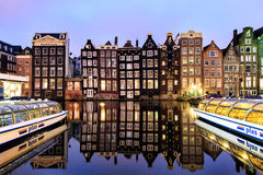 Dutch scenery with its canal side houses and tour boats Royalty Free Stock Photography