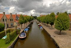 Dutch scenic. Authentic brick houses and a canal in Europe Royalty Free Stock Images