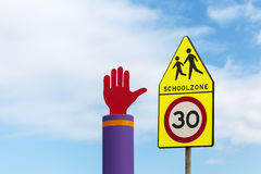 Dutch school zone warning road signs against a blue sky Royalty Free Stock Images