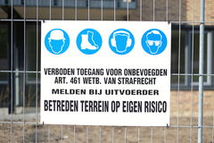 A Dutch sign that says 'No entry'. A Dutch sign near a construction site that says 'No entry', entering prohibited and forbidden by law, enter at own risk Stock Photography
