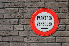 Dutch sign that says 'Parking prohibited'. A red and white Dutch sign that says that parking is prohibited and forbidden at that particular spot Stock Photo