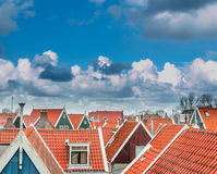 Dutch sky line. Moody sky over colorful dutch roofs in rural Holland Royalty Free Stock Photography
