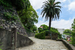 Dutch Slope (Oranda-zaka) in Nagasaki, Japan. Dutch Slope (Oranda-zaka) is the steep streets of former foreign settlement area in Nagasaki. Foreign merchants Stock Photos