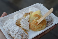 Dutch small mini pancakes. Typical Dutch small pancakes poffertjes sprinkeld with powdered sugar and served with butter Royalty Free Stock Image
