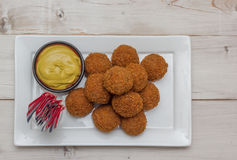 Dutch snack bitterballen with little dutch flags Stock Photography