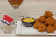 Dutch snack bitterballen with little flags and beer Stock Image