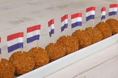 Dutch snacks with little dutch flags Royalty Free Stock Photos