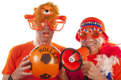 Dutch soccer supporters. In orange on white background Royalty Free Stock Photo