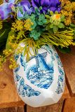 Dutch souvenir clog with painted windmill royalty free stock photography