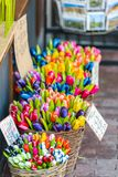 Wooden tulips for sale on an Amsterdam market. Dutch souvenirs - wooden tulips for sale on an Amsterdam market Royalty Free Stock Image