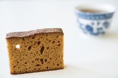 Dutch spiced bread called Ontbijtkoek or Peperkoek. And mug of coffee stock images