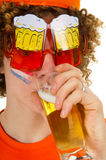 Dutch sports fan is drinking beer Royalty Free Stock Image