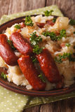 Dutch stamppot of potatoes, cabbage and carrots, with sausages c Stock Photo