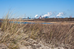 Dutch steel factory seen from the coast Stock Images