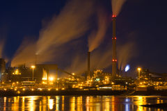 Dutch steel factory with smokestacks at night Stock Photo