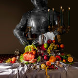 Dutch still life, with a knight in armor stock photos