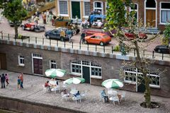 Dutch street cafe in the miniature city Madurodam. Dutch street cafe on the channel embankment in the miniature city Madurodam (the Netherlands Royalty Free Stock Images