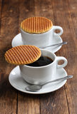 Dutch stroopwafel. Caramel waffle and coffee Royalty Free Stock Images