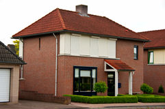 Dutch suburban house. A typical Dutch suburban house made of red brick Stock Photos