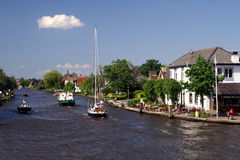 Dutch summerday. Small yachts sailing on a dutch canal Stock Photo