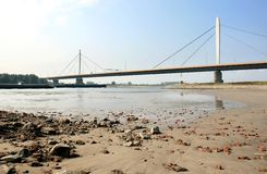 Dutch suspension bridge over the river Waal Stock Photo