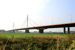 Dutch suspension bridge over the Waal river. The elegant Ewijk-bridge - a suspension bridge - was opened to traffic on june 30, 1976. It is a car bridge Royalty Free Stock Image